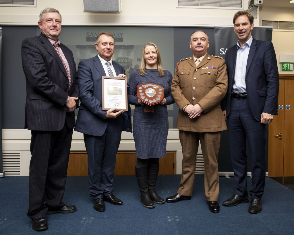 Members of the Energy Management Team of 29 Regiment, The Royal Logistic Corps, pose with their awards and Minster of Defence Personnel and Veterans, Tobias Ellwood MP.