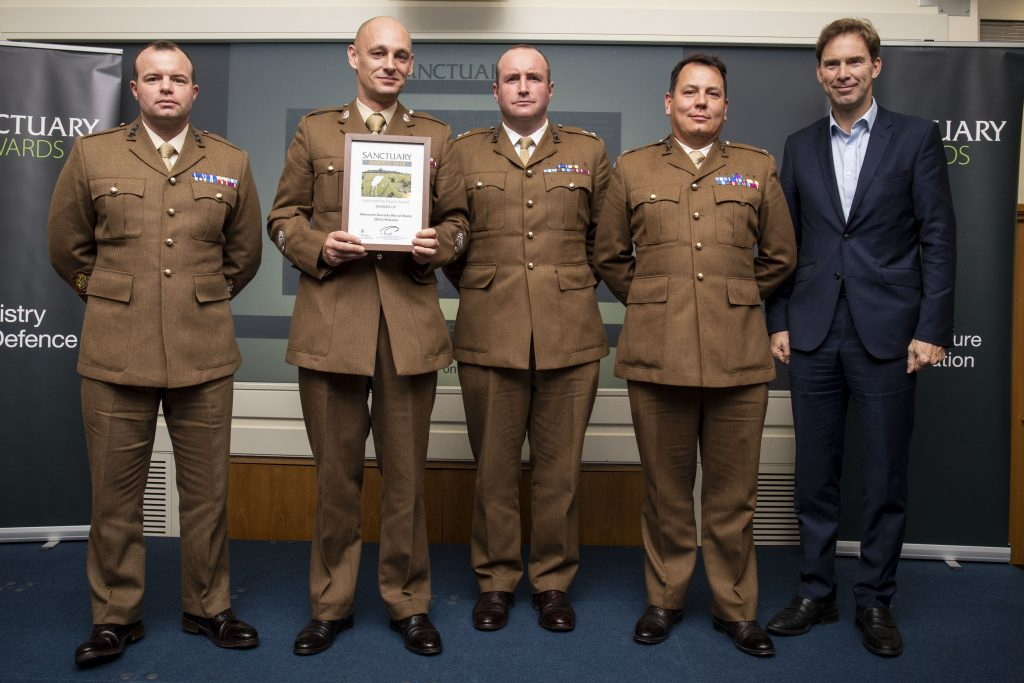 Soldiers from the Albermarle Barracks War on Waste team pose with their award and Minister of Defence Personnel and Veterans, Tobias Ellwood MP
