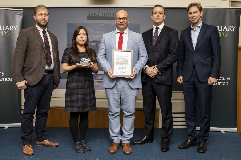 Representatives of Exercise MAGWITCH pose with their Silver Otter award and Minister of Defence Personnel and Veterans, Tobias Ellwood MP.