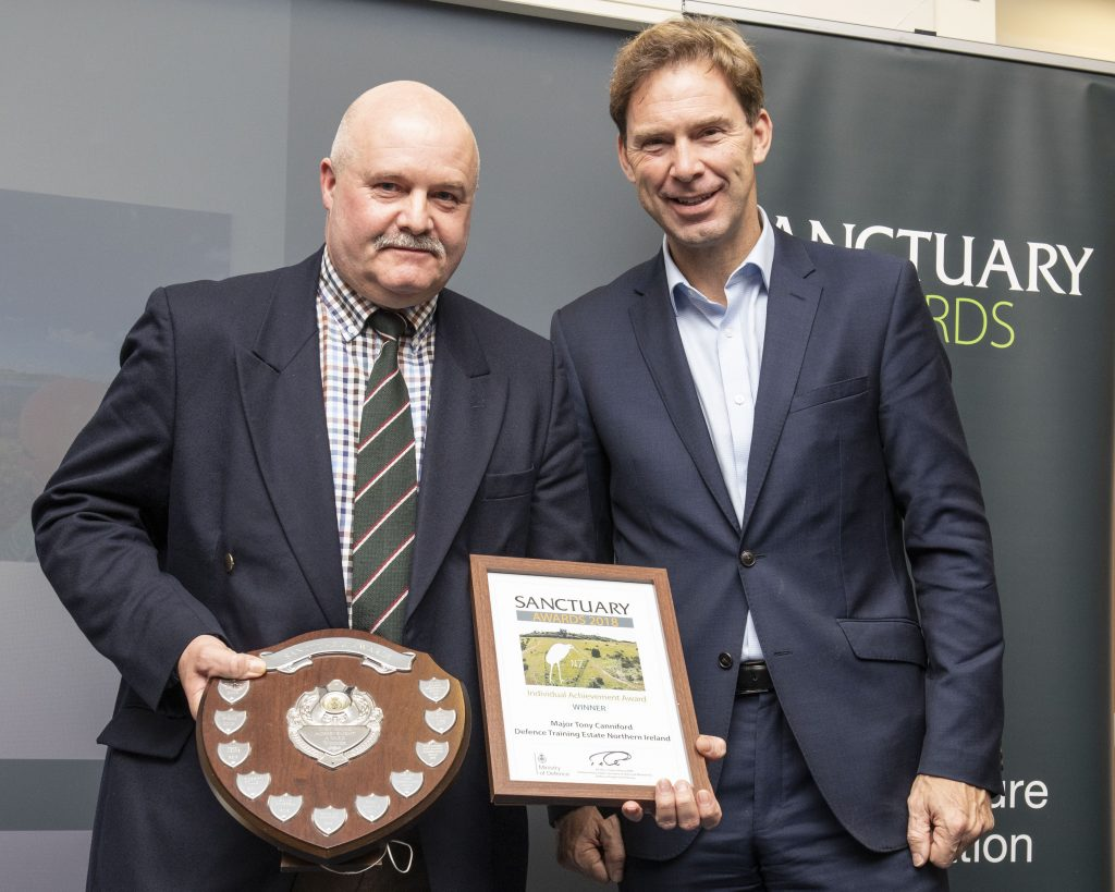 Major Tony Canniford with his award and Minister of Defence Personnel and Veterans, Tobias Ellwood MP.