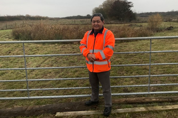 Major Udai Gurung, posing in a high-vis jacket in front of a gate on Fingringhoe Ranges.