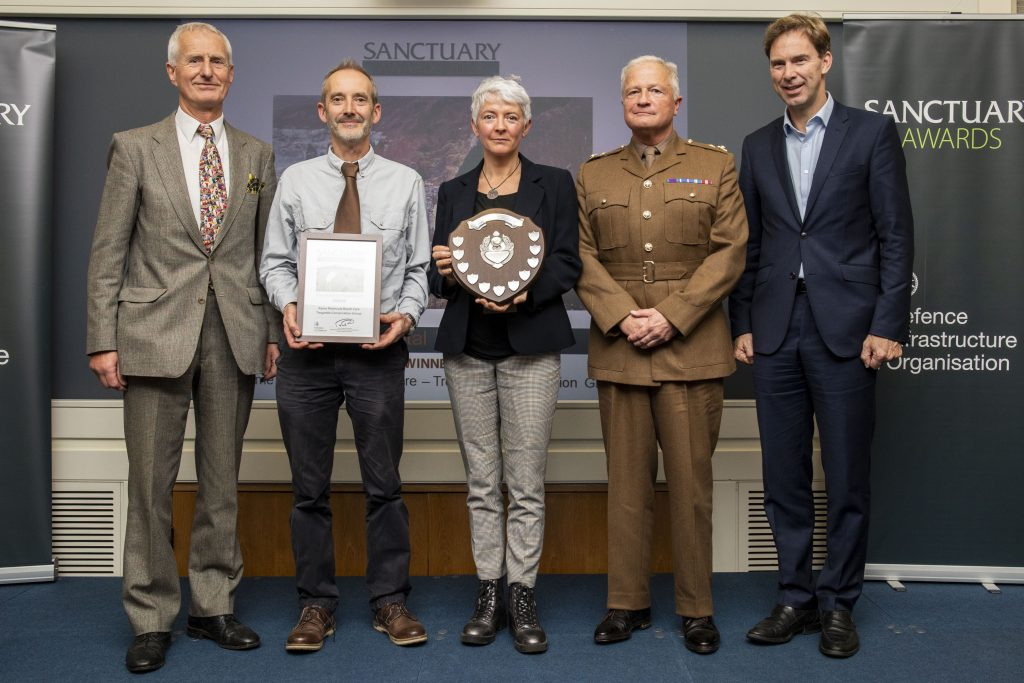 Representatives of the Rame Peninsula Beach Group pose with their award and Minister of Defence Personnel and Veterans, Tobias Ellwood MP.