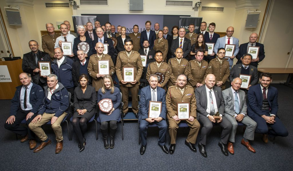 The winners and runners up pose in a group photo with their awards, certificates and Minister for Defence Personnel and Veterans, Tobias Ellwood MP.