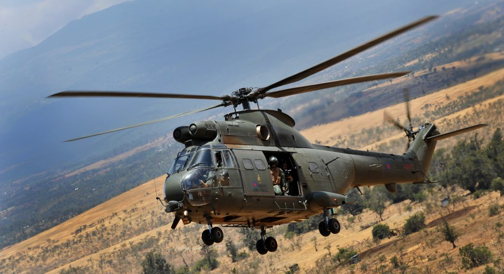 A Puma helicopter from the Royal Air Force flying over the Kenyan plains.