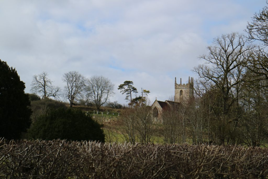 Landscape of the St Giles' Church in Imber in Salisbury Plain. The church is a scheduled monument that DIO manages and protects.