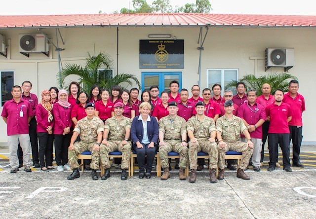 Group photo of Chief of Staff Lucy Bogue with DIO team in Brunei