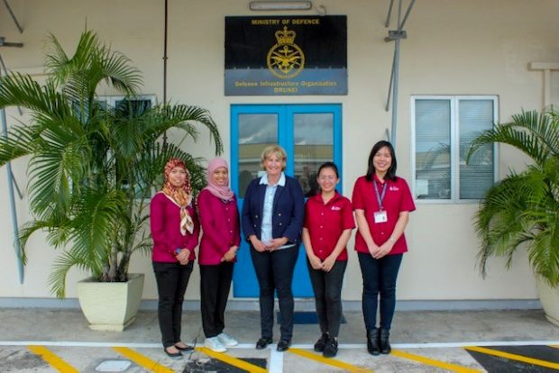 Lucy Bogue standing with four female staff members in front of a building.