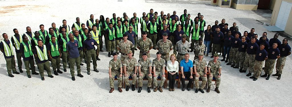 A posed image of Kate Harrison together with the military and civilian staff of BATSUB, including Locally Employed Civilians.