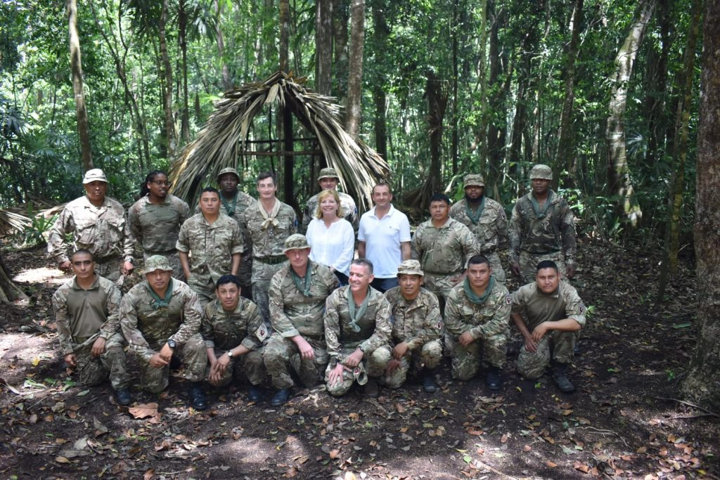 Kate Harrison posing with members of the 'Jungle School' in uniform, at BATSUB.