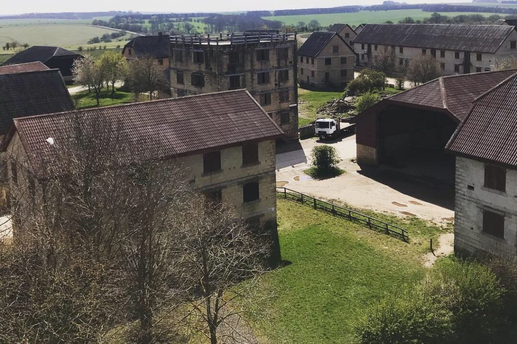 Pictured are a range of old empty buildings with open windows and fields around them to allow the Armed Forces to carry out vital training.